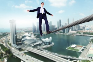 business-man-walking-high-wire-300x200